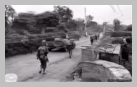 Image : 23 juillet 1944 : une colonne de la 4ème division d'infanterie américaine progresse au Hommet d'Arthenay au lieu dit La Maison Basset.
