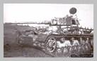 Image : Un char Panzer IV du 9ème escadron du S.S. Panzer-Regiment 12, détruit près de la localité d'Esquay-notre-Dame à la fin du mois de juin 1944.