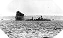 Image : L'USS Arkansas bombardant la batterie de Longues-sur-Mer le 6 juin 1944