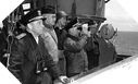 Image : De gauche à droite : Kirk, Bradley, Struble (jumelles) et Keen le Jour J sur l'USS Augusta